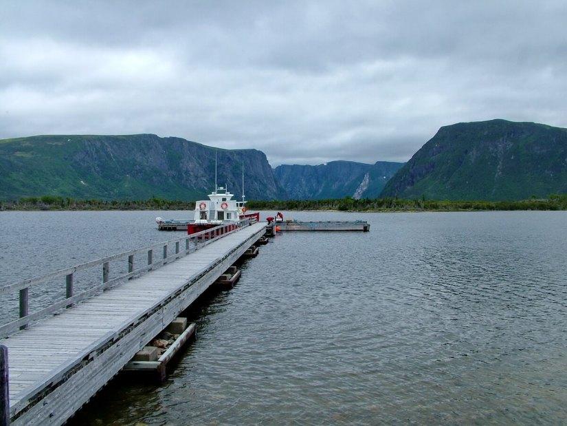 tour boat and dock on western brook pond, gros morne national park, newfoundland, canada