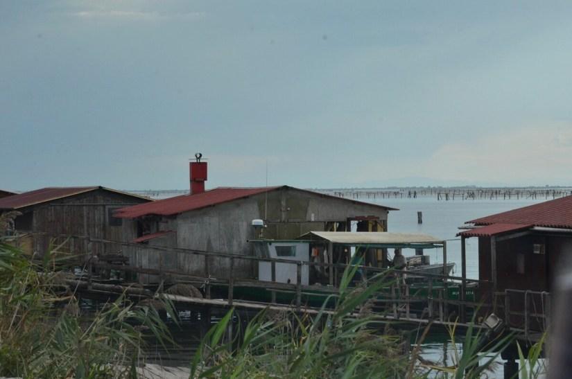 fishing houses on a lagoon, parco regionale veneto del delta del po, po river delta, italy