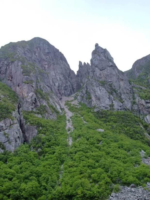 rocky cliff face, western brook pond, gros morne national park, newfoundland, canada