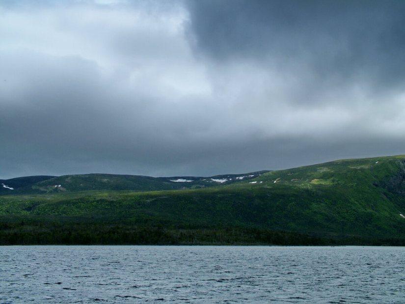 threatening clouds over western brook pond, gros morne national park, newfoundland, canada