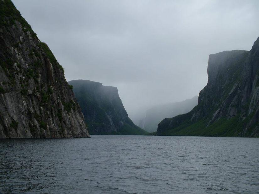sheer mountainsides, western brook pond, gros morne national park, newfoundland, canada