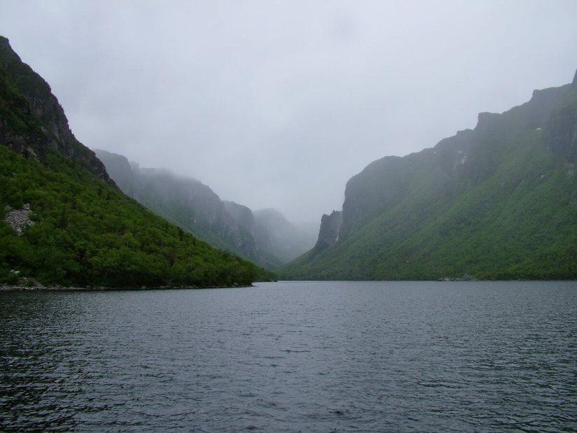 fog over the fjord, western brook pond, gros morne national park, newfoundland, canada