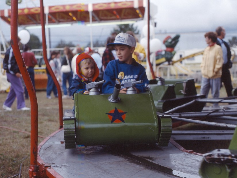 children on a kiddie ride, markham fair, 1990