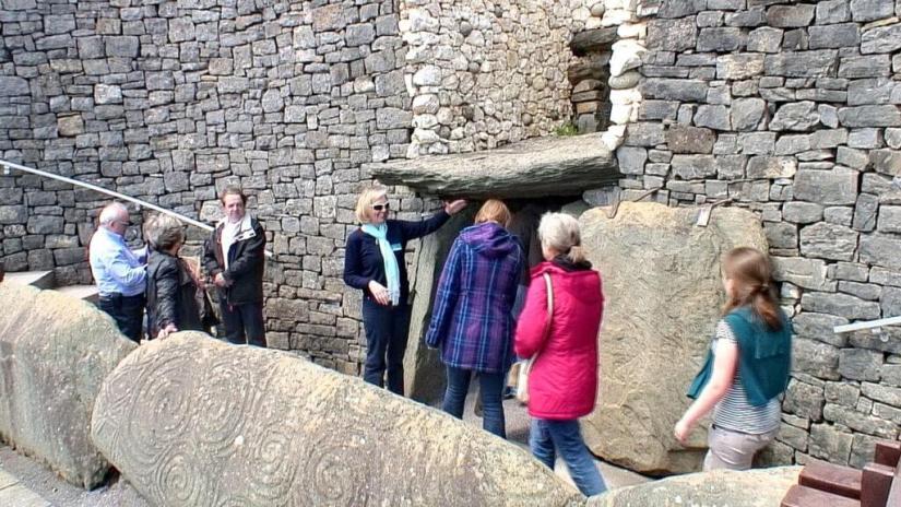 a tour group entering newgrange, county meath, ireland