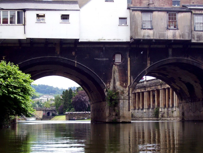 pulteney bridge and empire hotel, avon river, bath, england