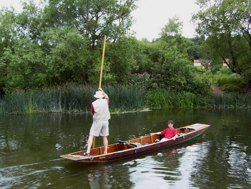 bob punting on the avon river, bath, england