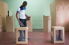 DOMINICAN REPUBLIC, Santo Domingo : A man casts his vote at a polling station during general elections in Santo Domingo on May 15, 2016. Voting began Sunday in the Dominican Republic's presidential election, where incumbent leader Danilo Medina is tipped to win despite grinding poverty and widespread crime. / AFP PHOTO / Fran Afonso