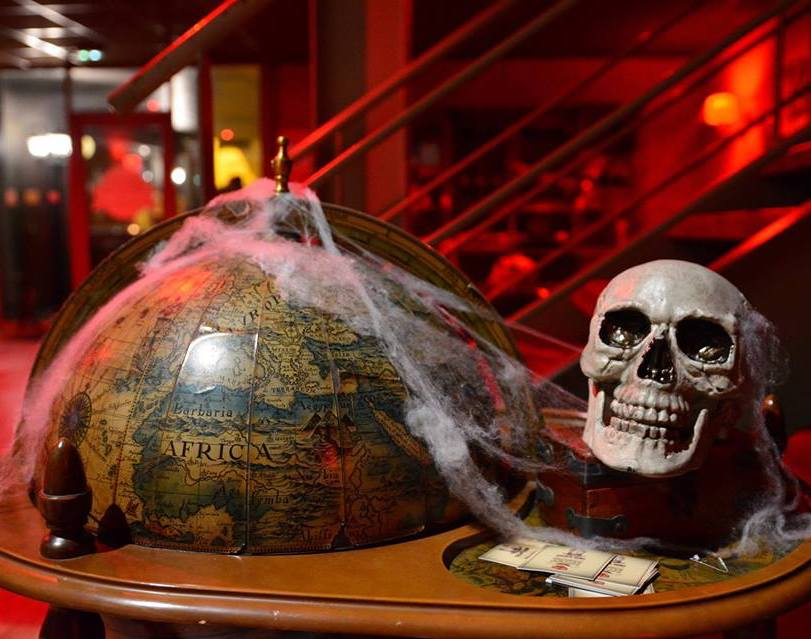 globe wrapped in spider web with skull halloween decorations escape game bordeaux france