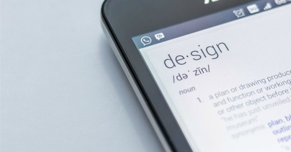 Schermo di iPhone con la parola Design