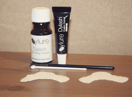 contents of the eylure dylash eyelash tinting kit, including the two mixes and lash guards, on a table