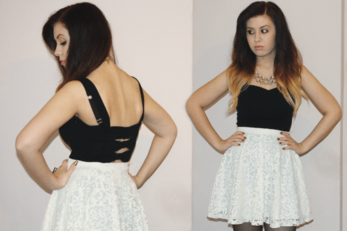blogger francesca sophia stands with her hands on her hips, wearing a black crop top with bow detailing on the back, and a white lace high waisted skater skirt