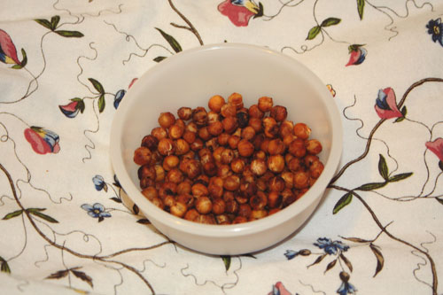 Spicy Roasted Chickpeas in a tupperware bowl, on an IKEA duvet on francescasophia.co.uk