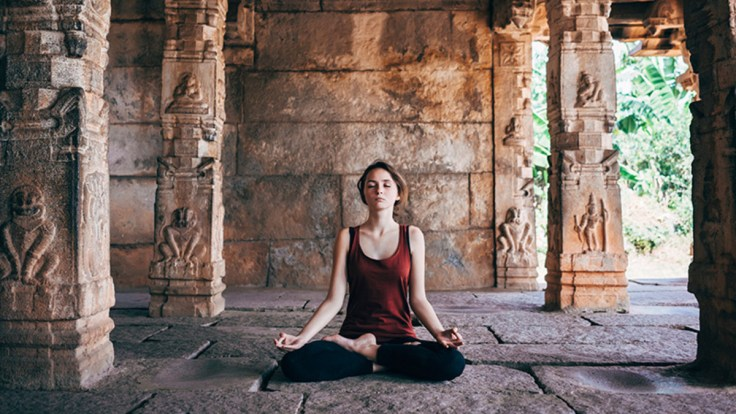woman-meditating-temple