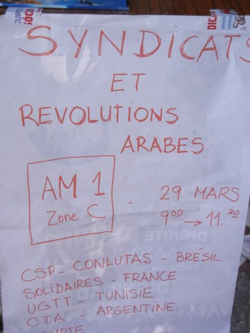 Labor unions and the Arab Revolutions; directing people to a meeting place and time; Brasil, France, Tunisia, Argentina; Zone C of WSF; 29 March 2013; photograph by Frances Hasso