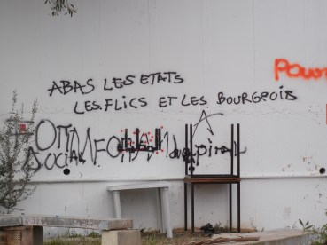 """""""Abas"""" (?) states, police, and the bourgeois...; 30 March 2013, Day 5. World Social Forum; photo by Frances Hasso"""