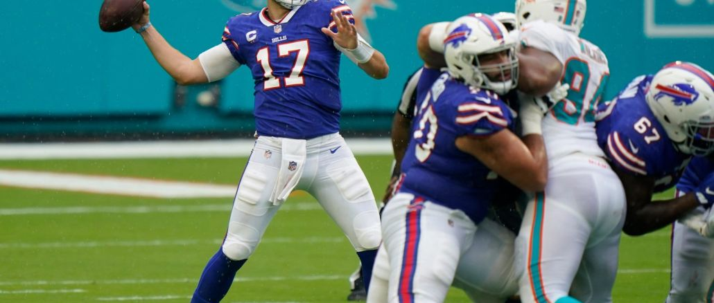 Josh Allen throws against Miami Dolphin