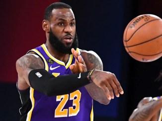 LeBron James passes basketball