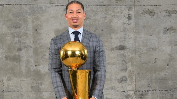 Ty Lue holds NBA trophy