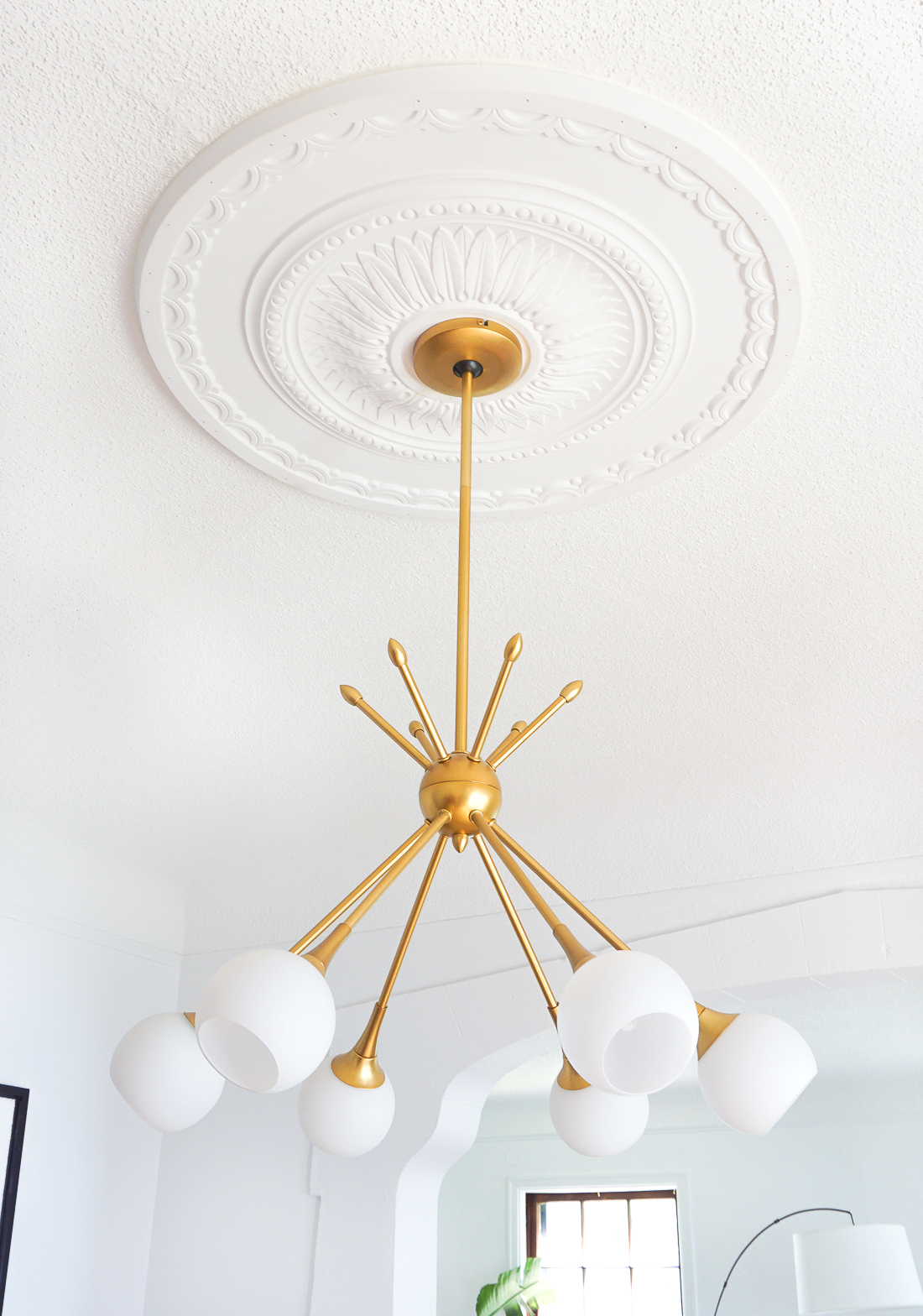 How to center a light fixture using a ceiling medallion francois use a ceiling medallion to center your light fixture over the dining table click to aloadofball Image collections