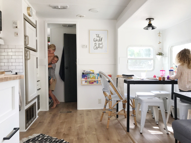 Take a peek inside this family of 5's fully renovated monochromatic RV. It's stylish small space living at its finest!