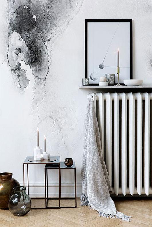 White interior, floating shelf over radiator, monocromatic room, herringbone floor, watercolor mural