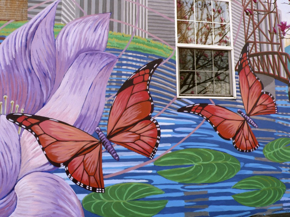 Building wall mural (I love the window with the magnolia reflections)