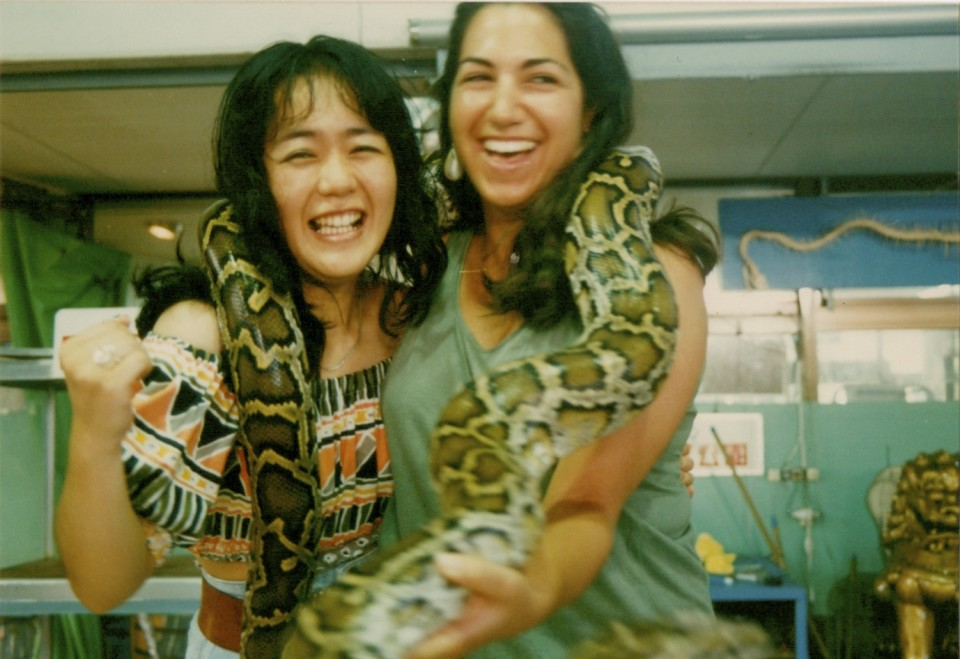 Just had to include this one!  Yuko and me with live boa constrictors around our necks!