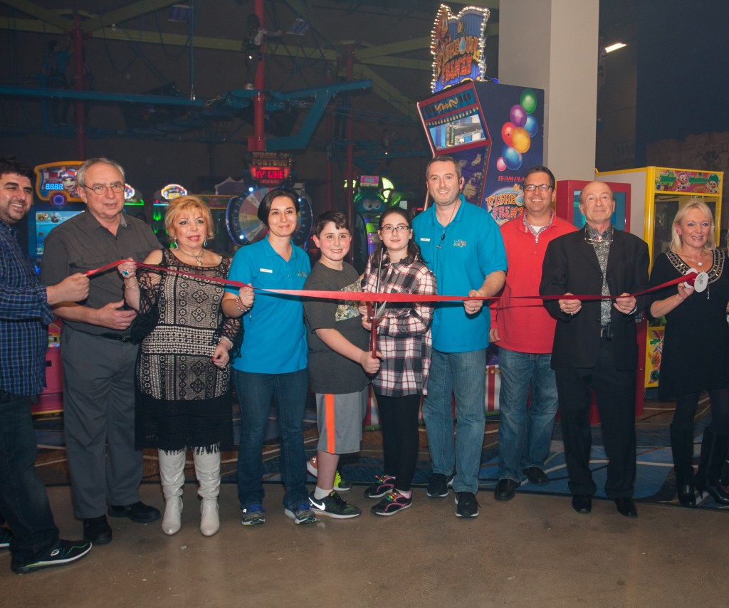 Ribbon Cutting with entire family and Mayor of Parma (1-r) Roman (Elena's brother), Dad Mike, Mom-Mila, Elena, Yuri, Rebecca, Sean, Yuri's Dad-Victor, Yuri's Mom-Maya. Parma City Mayor Tim DeGetter is in red sweater.
