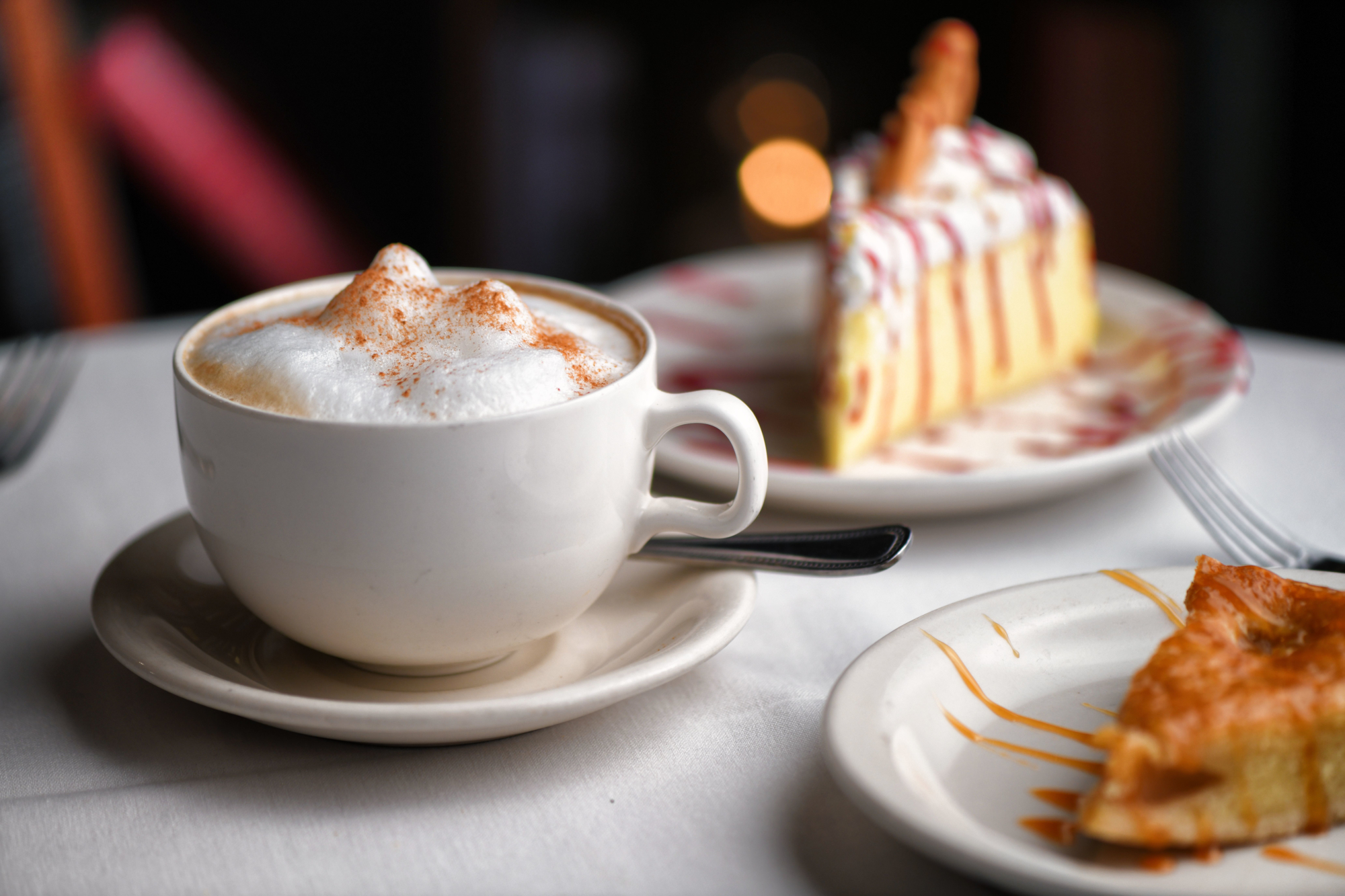 Cappuccino with Limoncello Mousse Cake topped with a butter cookie and a pear almond torte on the side