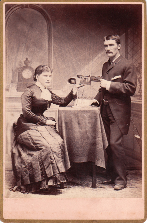 A cabinet card depicting a Victorian couple with their stereoscope.