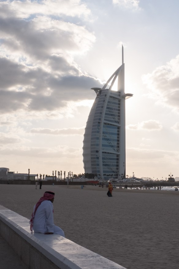 The architecturally unique Burj Al Arab stands, sail-like on its own island.
