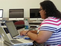 Veronica (Project Manager) working so hard she needs two laptops! Photograph by Rosemary Irvine