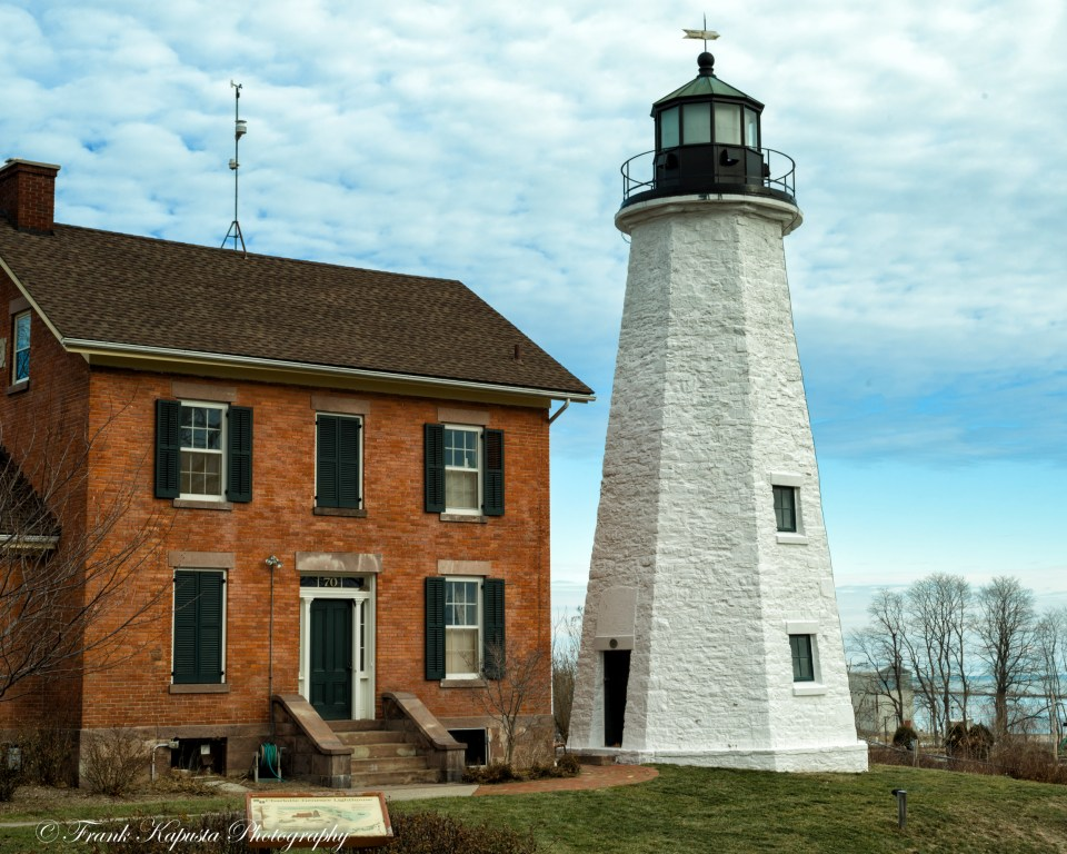 Located in the former Village of Charlotte at the Port of Rochester, NY. The Lighthouse was constructed in 1822 just west of the Genesee River and on the southern shore of Lake Ontario. The current keeper's house was built in 1863. It was restored by the Lighthouse Historical Society in 1984 and it is a City of Rochester designated landmark.
