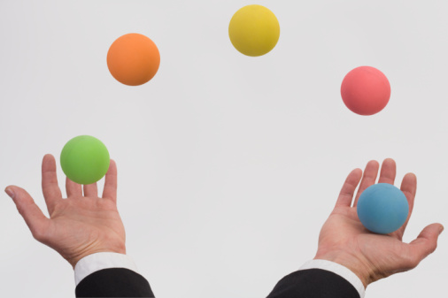 Man juggling various colored balls (Digital Composite)