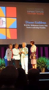 Diane Giddens accepts the Anne T. Rutherford Exemplary Community Volunteer Award from Anne T. Rutherford while flanked by nominators Debbie Henry (left) and Paula Harris (right).