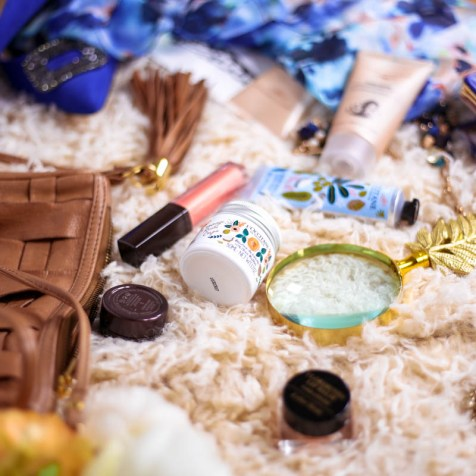 New Beauty Highlights | L'Occitane Shea Rifle Paper Co Collection & Laura Mercier makeup scattered on rug with fashion scarf and wallet