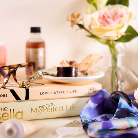 New Beauty Highlights | Makeup & bodycare and beauty items on dressing table with fashion items & book