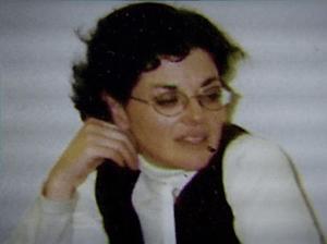 Nancy Salzman in White Shirt and Black Vest