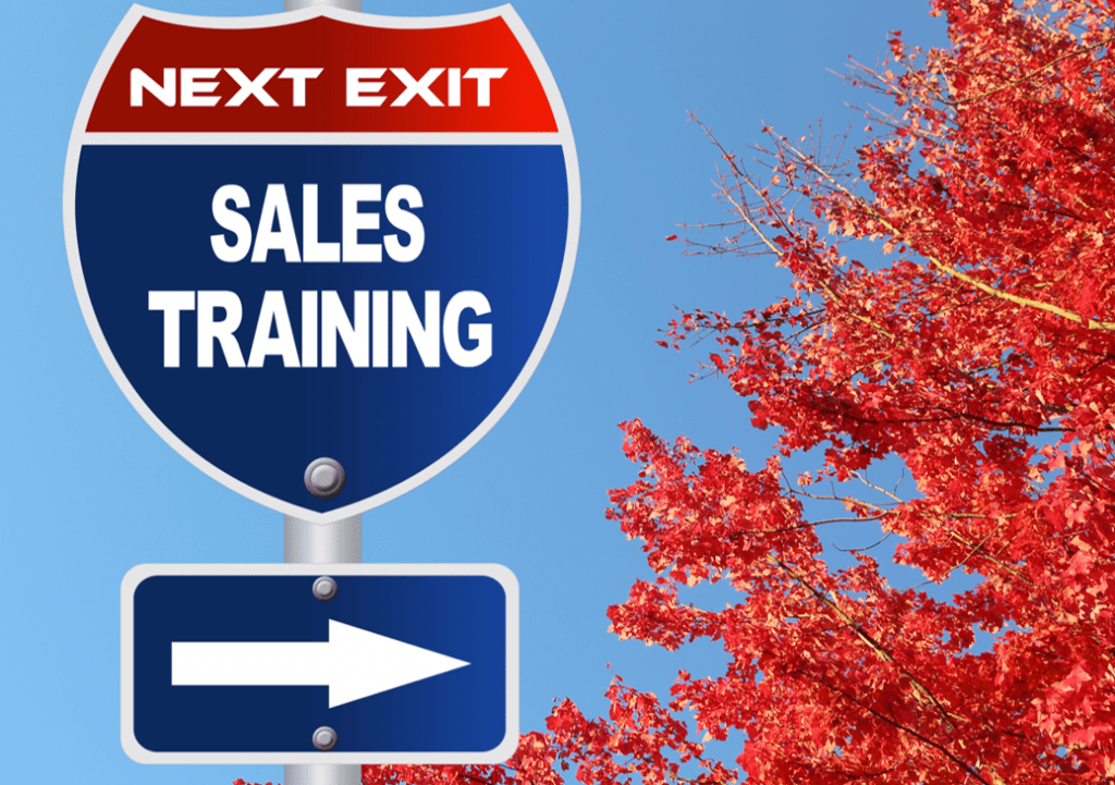 Highway Interstate sign that reads Sales Training next exit