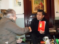 My mother gives her memoirs to a Catholic Bishop in China.