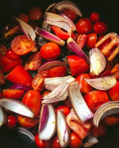 Tomatoes and onions ready for roasting