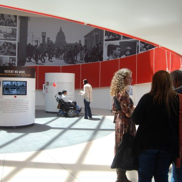 A view of the Rotunda at the Ed Roberts Center, with mural in the background