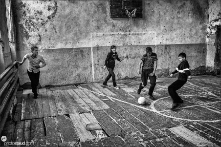 Playing football in a derelict sport hall in Armenia