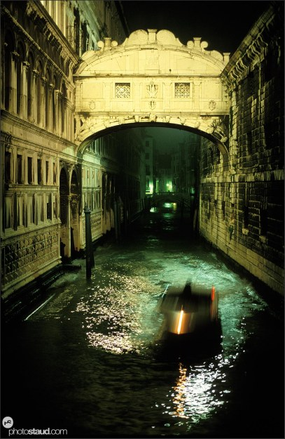 Boat passing beneath Ponte dei Sospiri (Bridge of Sighs) Venice by night, Italy