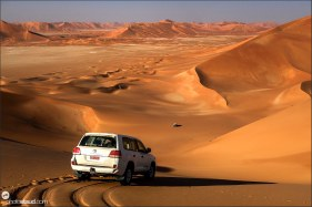 Two cars in the landscape of Empty Quarter, Rub al Khali Desert, Oman