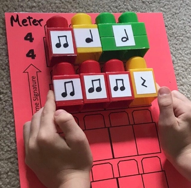 Child Creating Music Composition Using Rhythm Blocks and a Template