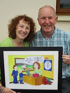A picture of Brigid and her husband with her caricature