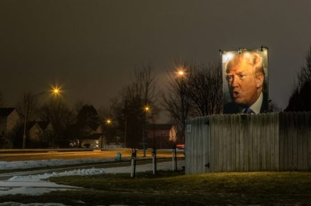 A photograph of president-elect Donald J. Trump, lit up with flood lights, in a suburban Iowa backyard. (Photo: Tony Webster/flickr)