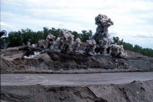 Blasting in an open cut mine