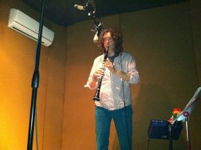 "John playing ""chaotic clarinets"" for the album"